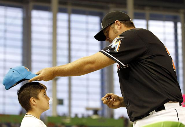 MIAMI, FL - APRIL 13: Pitcher Heath Bell of the Miami Marlins signs autographs before playing against the Houston Astros at Marlins Park on April 13, 2012 in Miami, Florida. (Photo by Marc Serota/Getty Images)