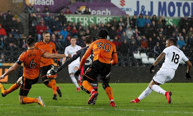 Jordan Ayew (right) puts Swansea ahead after weaving through the Wolves defence.