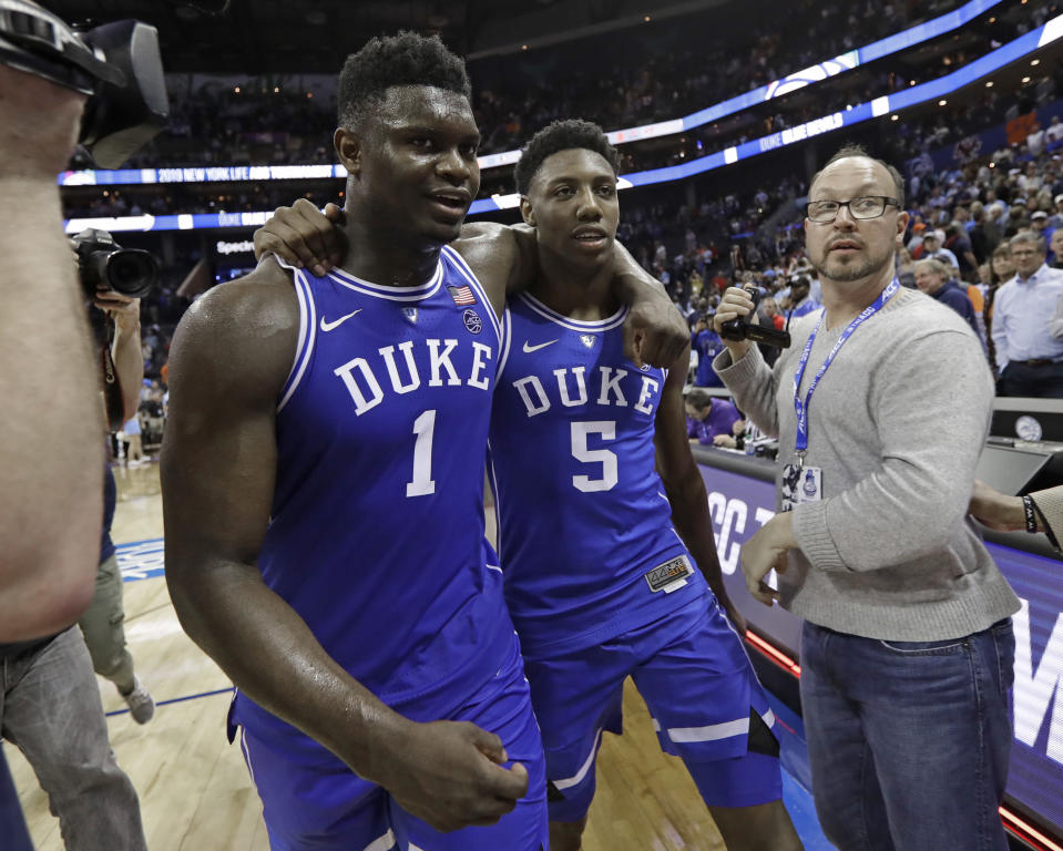 Duke's Zion Williamson (L) and RJ Barrett embrace as they leave the court after Duke defeated North Carolina on Friday. (AP)