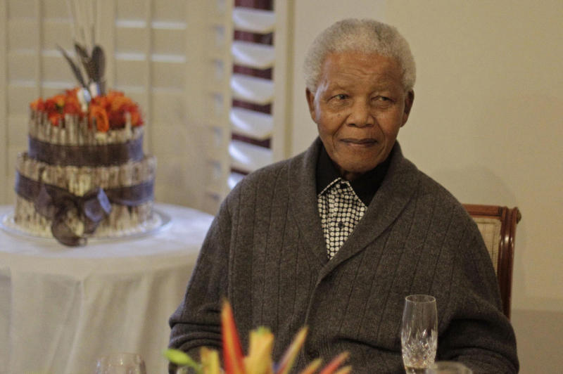 """FILE - In this Wednesday, July 18, 2012 file photo, former South African President Nelson Mandela as he celebrates his 94th birthday with family in Qunu, South Africa. It was reported on Wednesday, Dec. 4, 2013 that the family of ailing former South African President Nelson Mandela has told the South African Broadcasting Corporation in an interview that the liberation struggle icon is not """"doing well"""" but is continuing to put up a courageous fight from his """"deathbed."""" (AP Photo/Schalk van Zuydam, File)"""