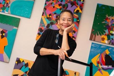Synthia SAINT JAMES among some original paintings in her Los Angeles studio.