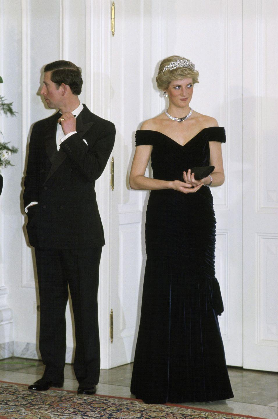 <p>Princess Diana's velvet dress by Victor Edelstein is one of her more iconic ensembles. The Princess wore this dress during a visit to the White House in 1985, where she famously danced with John Travolta. Diana re-wore it two years later on a state visit in Germany, as seen here. </p>