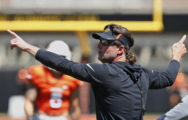 Oklahoma State head coach Mike Gundy gestures to his team during an NCAA college football intra-squad scrimmage in Stillwater, Okla., Saturday, April 28, 2018. (AP Photo/Sue Ogrocki)