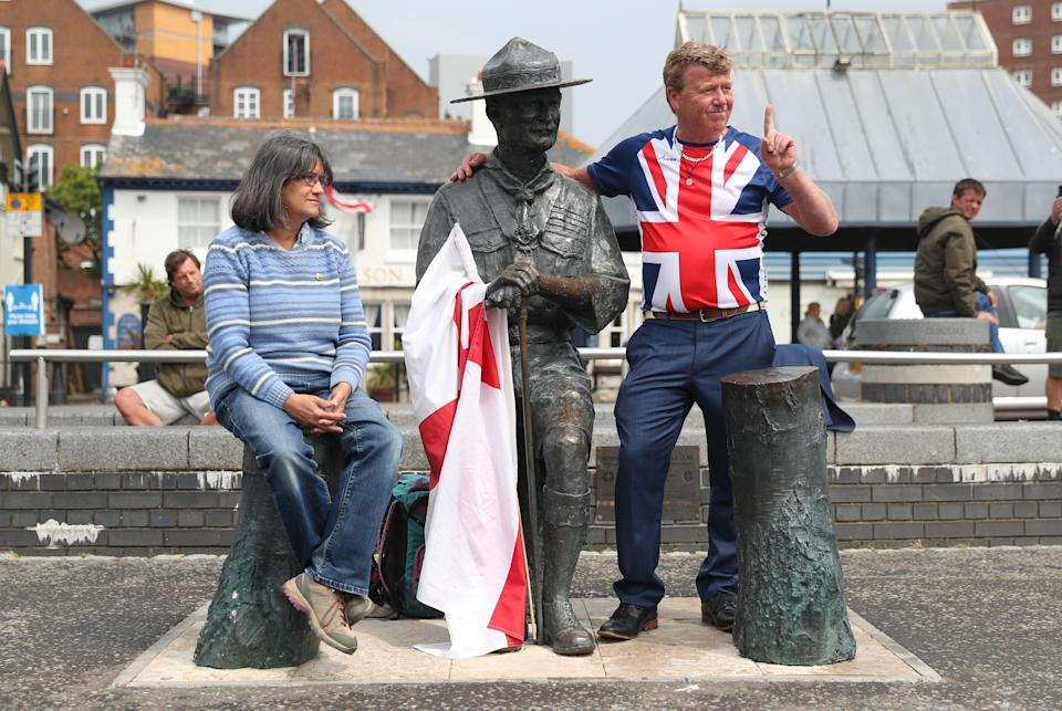 """Locals show their support for a statue of Robert Baden-Powell on Poole Quay in Dorset ahead of its expected removal to """"safe storage"""" following concerns about his actions while in the military and """"Nazi sympathies"""". The action follows a raft of Black Lives Matter protests across the UK, sparked by the death of George Floyd, who was killed on May 25 while in police custody in the US city of Minneapolis."""