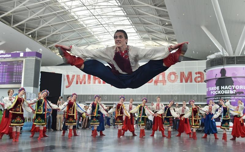 A troupe of Ukrainian dancers helped celebrate the new visa-free regime at Boryspil airport in Kiev (AFP Photo/SERGEI SUPINSKY                     )