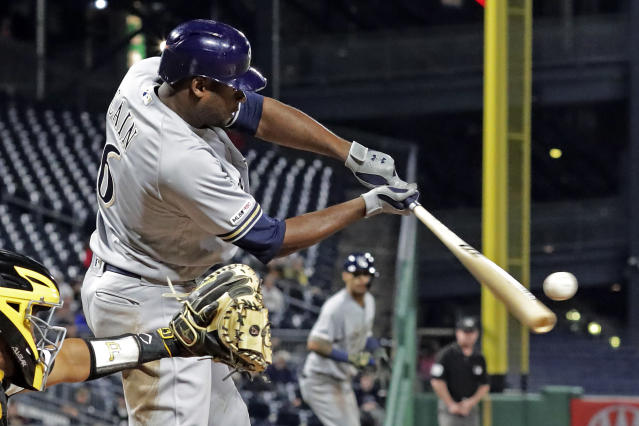 Milwaukee Brewers' Lorenzo Cain hits a three-run double off Pittsburgh Pirates relief pitcher Richard Rodriguez during the ninth inning of a baseball game in Pittsburgh, Thursday, May 30, 2019. The Brewers won 11-5. (AP Photo/Gene J. Puskar)