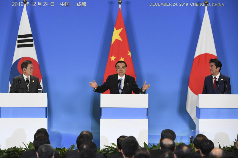 China's Premier Li Keqiang, center, speaks as South Korean President Moon Jae-in, left, and Japanese Prime Minister Shinzo Abe, right, look on, at a joint press conference during their trilateral leaders' meeting in Chengdu, southwest China's Sichuan province Tuesday, Dec. 24, 2019. Leaders from China, Japan and South Korea were meeting Tuesday against the backdrop of increasing threats from North Korea's nuclear and missile programs. (Wang Zhao/Pool Photo via AP)