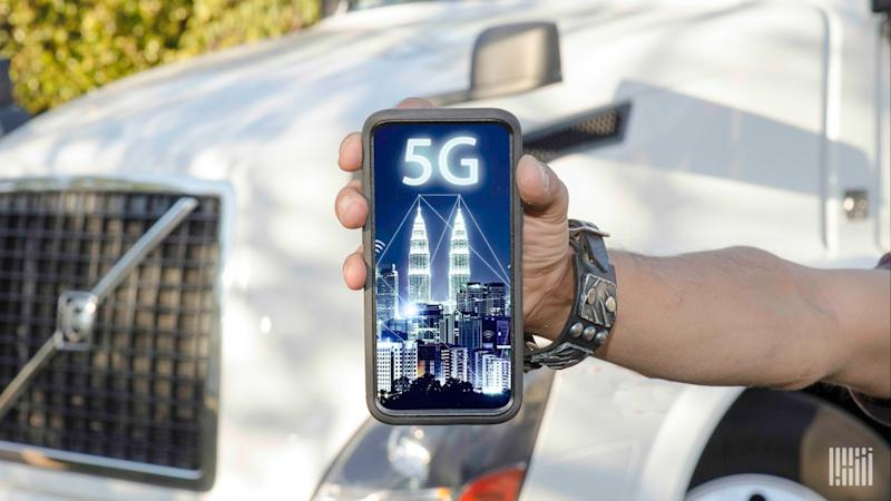 When will cellphones move from 4G to 5G? (Hand holding a cellphone with '5G' on picture.