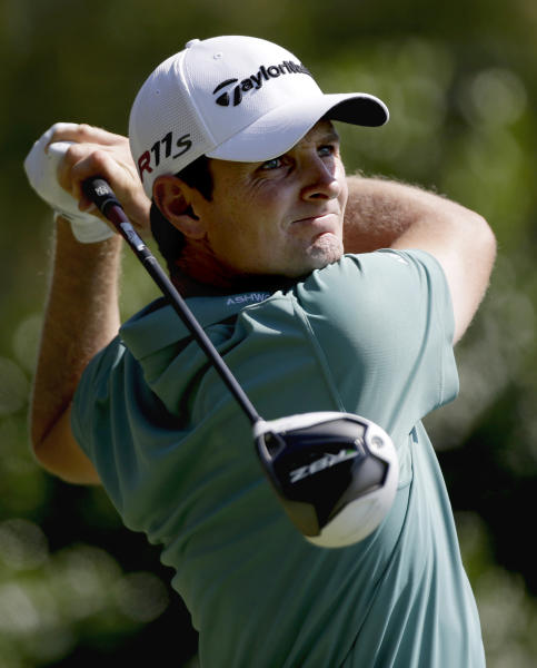 Justin Rose, of England, tees off the third hole during the third round of the Tour Championship golf tournament Saturday, Sept. 22, 2012, in Atlanta. (AP Photo/David Goldman)