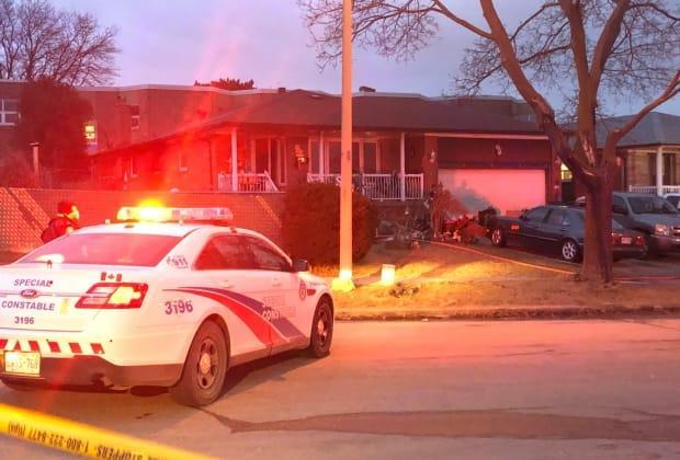 There was heavy smoke and flames when emergency crews arrived at the home, police said. (Linda Ward/CBC - image credit)