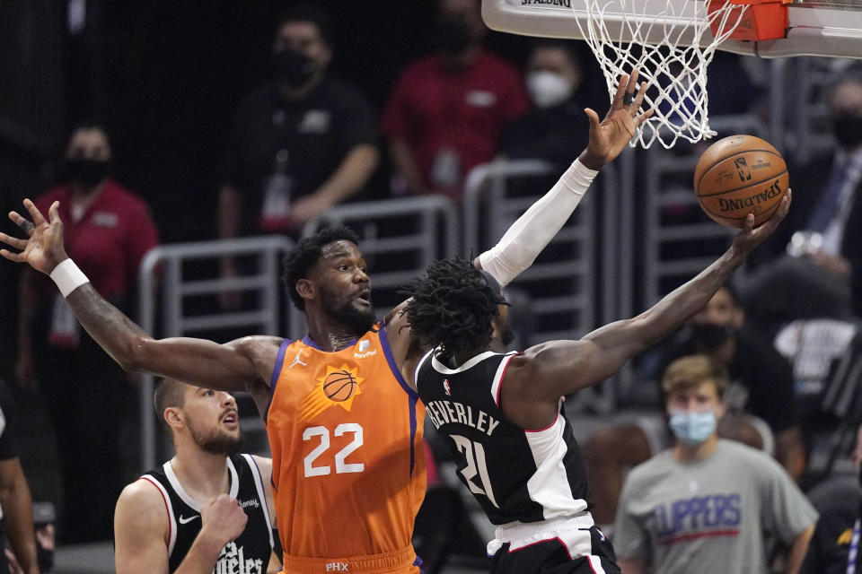Los Angeles Clippers guard Patrick Beverley, right, shoots as Phoenix Suns center Deandre Ayton defends during the first half in Game 3 of the NBA basketball Western Conference Finals Thursday, June 24, 2021, in Los Angeles. (AP Photo/Mark J. Terrill)