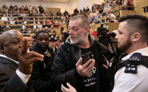The demonstrators were removed from the conference to the sound of cheers - Credit: SIMON DAWSON/REUTERS