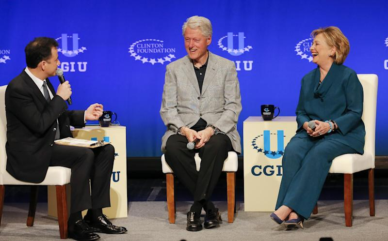 Former President Bill Clinton, center, former Secretary of State Hillary Rodham Clinton, right, speak with talk show host Jimmy Kimmel during a student conference for the Clinton Global Initiative University, Saturday, March 22, 2014, at Arizona State University in Tempe, Ariz. More than 1,000 college students are gathered at Arizona State University this weekend as part of the Clinton Global Initiative University's efforts to advance solutions to pressing world challenges. (AP Photo/Matt York)