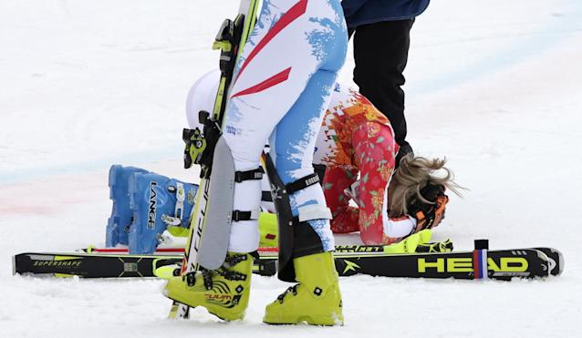 Germany's Maria Hoefl-Riesch drops to her knees the moment she realizes she has won the gold medal in the women's supercombined at the Sochi 2014 Winter Olympics, Monday, Feb. 10, 2014, in Krasnaya Polyana, Russia. (AP Photo/Gero Breloer)