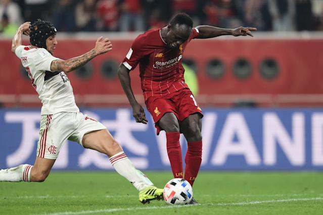 Mane striking the ball as Rafinha comes in from behind (Photo by Matthew Ashton - AMA/Getty Images)