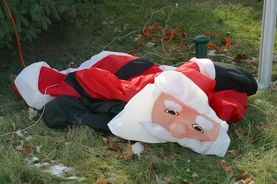 Holiday Fatigue. Inflatable Santa Claus with the wind knocked out of him. Might represent stress of the Christmas Season.