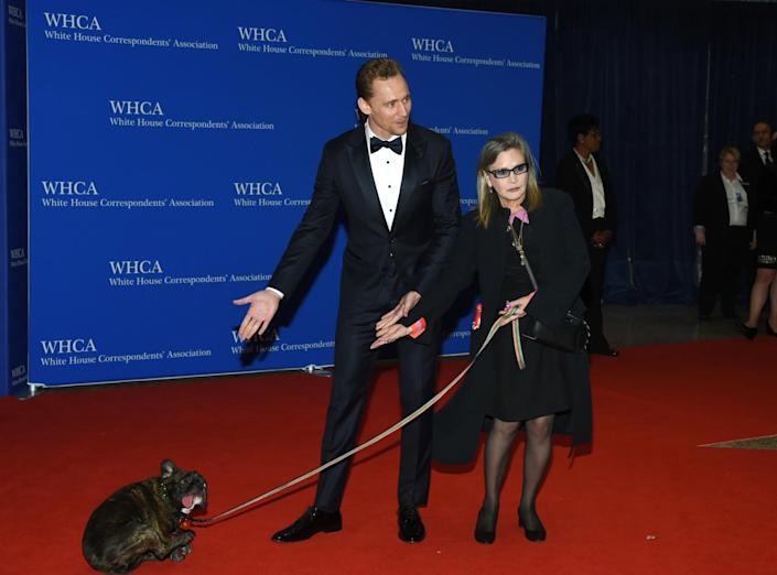 <p>Actors Tom Hiddleston and Carrie Fisher arrive at the White House Correspondents' Dinner, April 30. <i>(Photo: Evan Agostini/Invision/AP)</i></p>