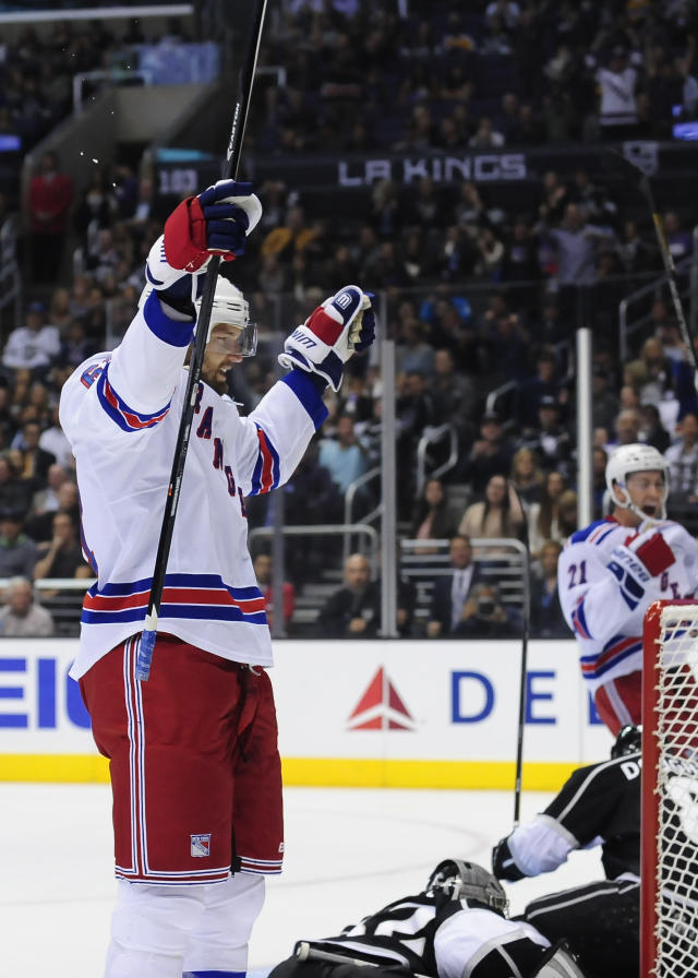 New York Rangers left wing Rick Nash celebrates after his shot was knocked in by center Brad Richards for a goal by Richards during the first period of an NHL hockey game against the Los Angeles Kings, Monday, Oct. 7, 2013, in Los Angeles. (AP Photo/Gus Ruelas)