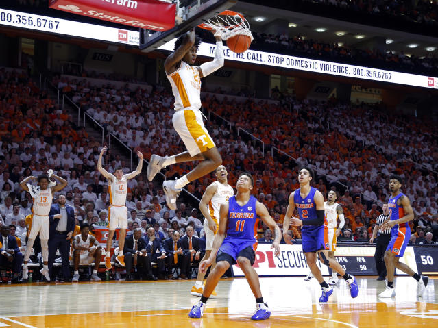 Tennessee guard Jordan Bowden (23) dunks over Florida forward Keyontae Johnson (11) during the second half of an NCAA college basketball game Saturday, Feb. 9, 2019, in Knoxville, Tenn. Tennessee won 73-61. (AP photo/Wade Payne)