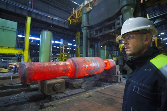 A worker standing in front of red hot steel