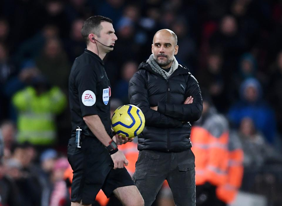 LIVERPOOL, ENGLAND - NOVEMBER 10: Pep Guardiola, Manager of Manchester City stares at referee Michael Oliver as he walks onto the pitch for the second halfduring the Premier League match between Liverpool FC and Manchester City at Anfield on November 10, 2019 in Liverpool, United Kingdom. (Photo by Laurence Griffiths/Getty Images)