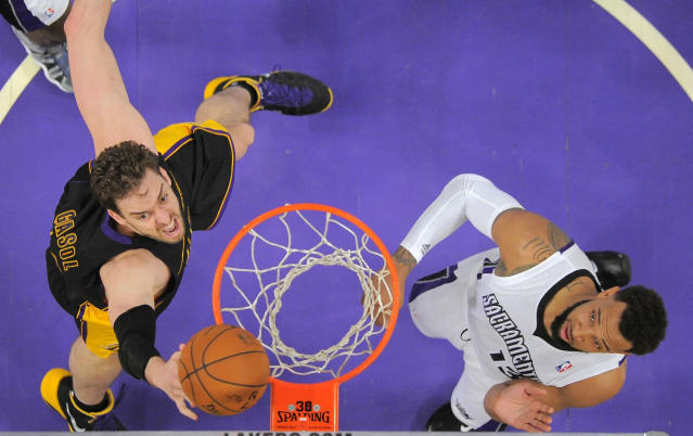 Los Angeles Lakers center Pau Gasol, left, of Spain, puts up a shot as Sacramento Kings forward Derrick Williams defends during the first half of an NBA basketball game, Friday, Feb. 28, 2014, in Los Angeles. (AP Photo/Mark J. Terrill)