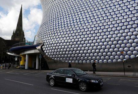 An Uber taxi is driven past the Selfridges building in Birmingham