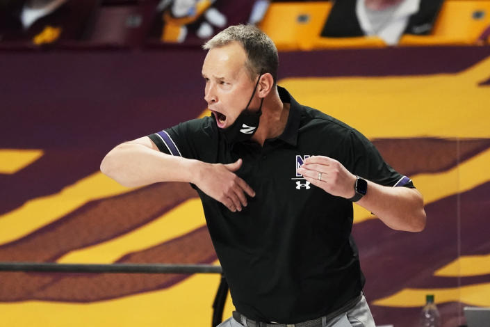 Northwestern head coach Chris Collins directs his players in the second half of an NCAA college basketball game against Minnesota , Thursday, Feb. 25, 2021, in Minneapolis. (AP Photo/Jim Mone)