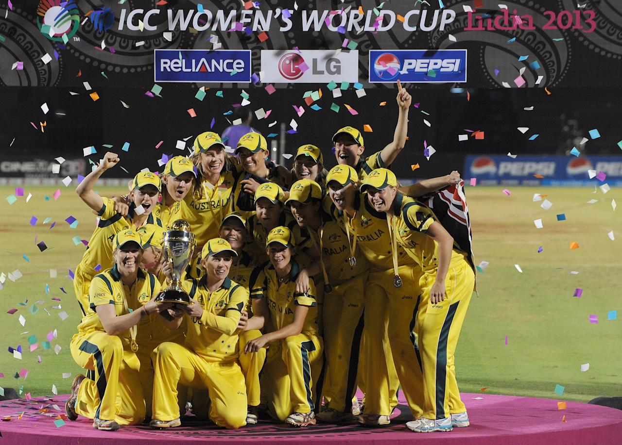 The victorious Australian cricket team poses with their Champion's trophy after winning the ICC Women's World Cup 2013 between Australia and West Indies at the Cricket Club of India's Brabourne stadium in Mumbai on February 17, 2013. Australia won the match by 114 runs. AFP PHOTO/Indranil MUKHERJEE