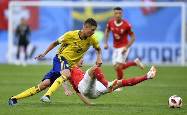 <p>Sweden's Mikael Lustig, left, and Switzerland's Granit Xhaka challenge for the ball during the round of 16 match between Switzerland and Sweden at the 2018 soccer World Cup in the St. Petersburg Stadium, in St. Petersburg, Russia, Tuesday, July 3, 2018. (AP Photo/Martin Meissner) </p>