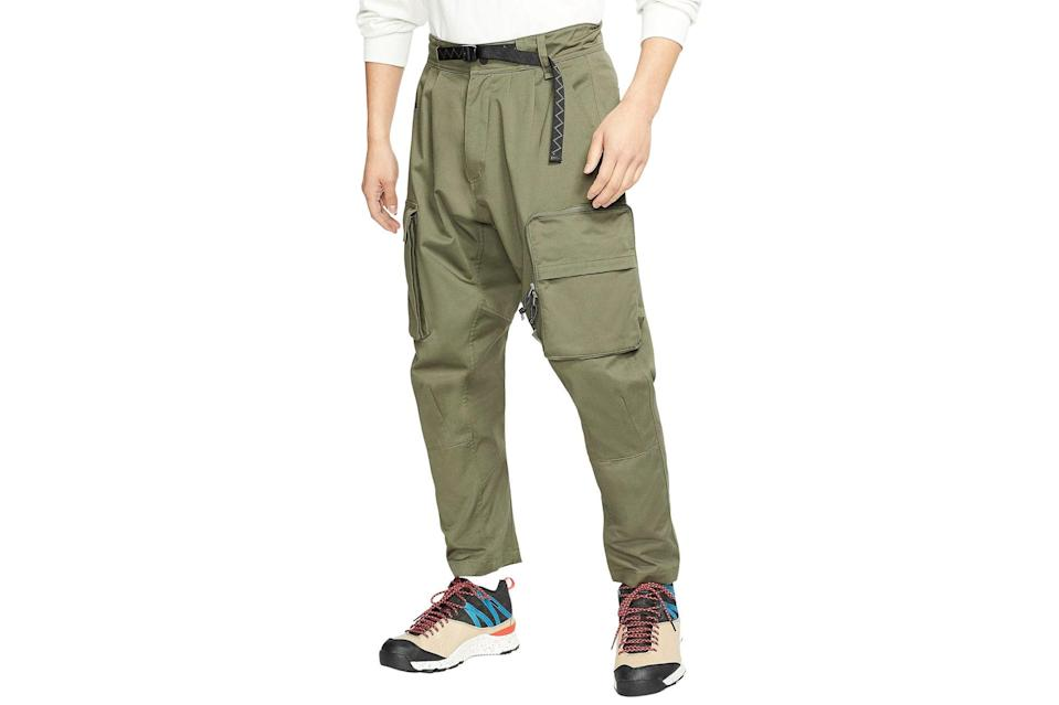 """<p>Look like you're ready for a hike at all times.</p> <p><em>Nike ACG woven cargo pants</em></p> $180, Nike. <a href=""""https://www.nike.com/t/acg-mens-woven-cargo-pants-1mjNlw/CD7646-325"""" rel=""""nofollow noopener"""" target=""""_blank"""" data-ylk=""""slk:Get it now!"""" class=""""link rapid-noclick-resp"""">Get it now!</a>"""