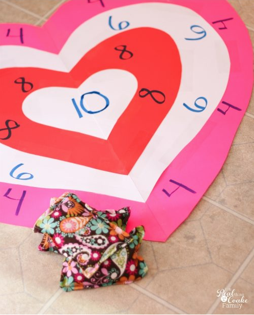 """<p>If the weather is nice enough, take this bean bag toss outside. </p><p><strong>Get the tutorial at <a href=""""https://realcreativerealorganized.com/activities-for-family-valentines-bean/"""" rel=""""nofollow noopener"""" target=""""_blank"""" data-ylk=""""slk:Real Creative, Real Organized"""" class=""""link rapid-noclick-resp"""">Real Creative, Real Organized</a>.</strong></p><p><strong><a class=""""link rapid-noclick-resp"""" href=""""https://www.amazon.com/Pacon-Super-Value-Poster-Sheets/dp/B000F8XIP6?tag=syn-yahoo-20&ascsubtag=%5Bartid%7C10050.g.25916974%5Bsrc%7Cyahoo-us"""" rel=""""nofollow noopener"""" target=""""_blank"""" data-ylk=""""slk:SHOP POSTER BOARD"""">SHOP POSTER BOARD</a><br></strong></p>"""