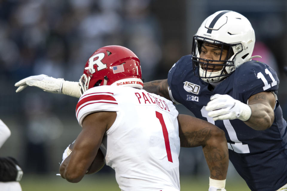 File-This Nov. 30, 2019, file photo shows Penn State linebacker Micah Parsons (11) tackling Rutgers running back Isaih Pacheco during an NCAA college football game in State College, Pa. Caleb Farley of Virginia Tech was the first top prospect to make the decision that has added a whole new layer of uncertainty to the annual crapshoot that is the NFL draft. Farley had plenty of players follow his lead, including several others set to be high draft picks next week like LSU receiver Chase, Oregon tackle Penei Sewell, Northwestern tackle Rashawn Slater, and Parsons. (AP Photo/Barry Reeger, File)