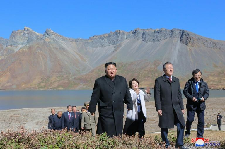North Korean leader Kim Jong Un (L) walking with South Korean President Moon Jae-in (2nd R) and his wife Kim Jung-sook (C) on the top of Mount Paektu after their summit this week