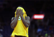 Valparaiso's Daniel Sackey hides his face following an NCAA college basketball game against Loyola of Chicago in the quarterfinal round of the Missouri Valley Conference tournament, Friday, March 8, 2019, in St. Louis. Loyola won 67-54. (AP Photo/Jeff Roberson)