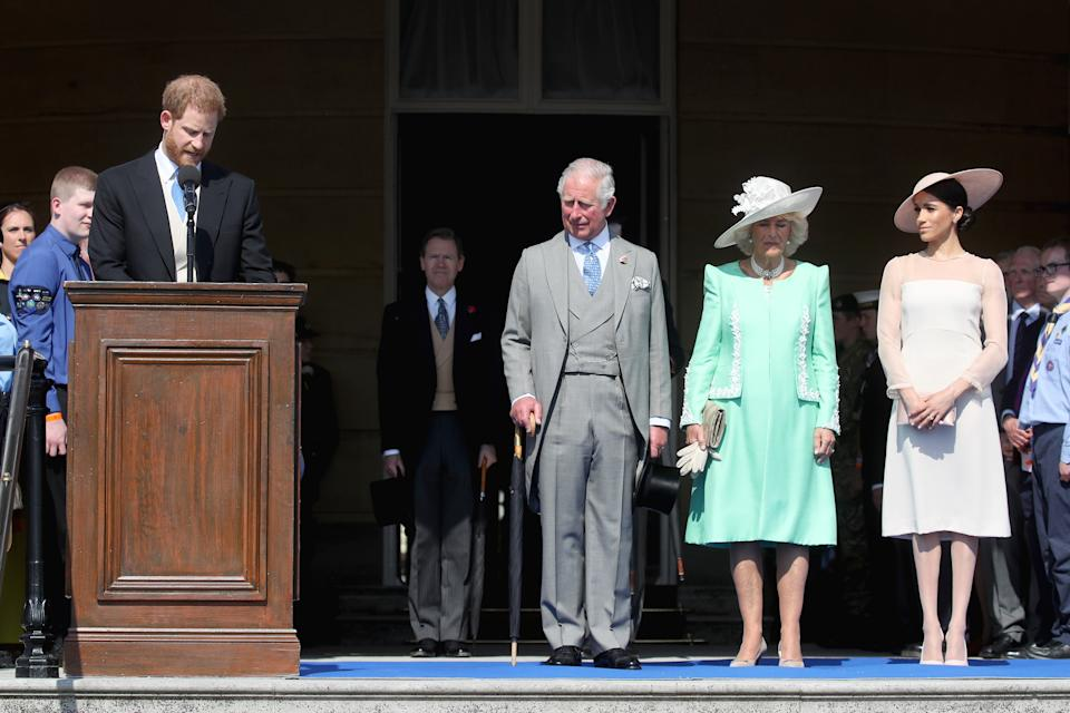 LONDON, ENGLAND - MAY 22:  (L-R) Prince Harry, Duke of Sussex gives a speech next to Prince Charles, Prince of Wales, Camilla, Duchess of Cornwall and Meghan, Duchess of Sussex as they attend The Prince of Wales' 70th Birthday Patronage Celebration held at Buckingham Palace on May 22, 2018 in London, England.  (Photo by Chris Jackson/Chris Jackson/Getty Images)
