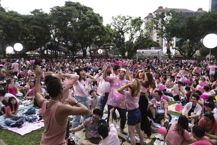 SINGAPORE, SINGAPORE - JUNE 29: Attendees dance during the Pink Dot event held at the Speaker's Corner in Hong Lim Park on June 29, 2019 in Singapore. (Photo by Ore Huiying/Getty Images)