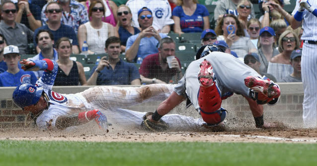 Chicago Cubs' Javier Baez steals home past Detroit Tigers catcher James McCann during the fourth inning of a baseball game on Wednesday, July 4, 2018, in Chicago. (AP Photo/Matt Marton)