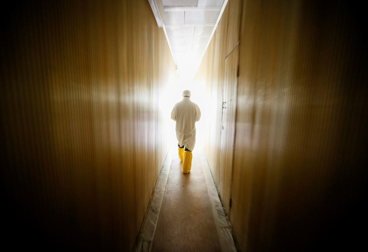 An employee walks through the corridor of the stopped third reactor at the Chernobyl nuclear power plant in Chernobyl, Ukraine April 20, 2018.  REUTERS/Gleb Garanich     TPX IMAGES OF THE DAY