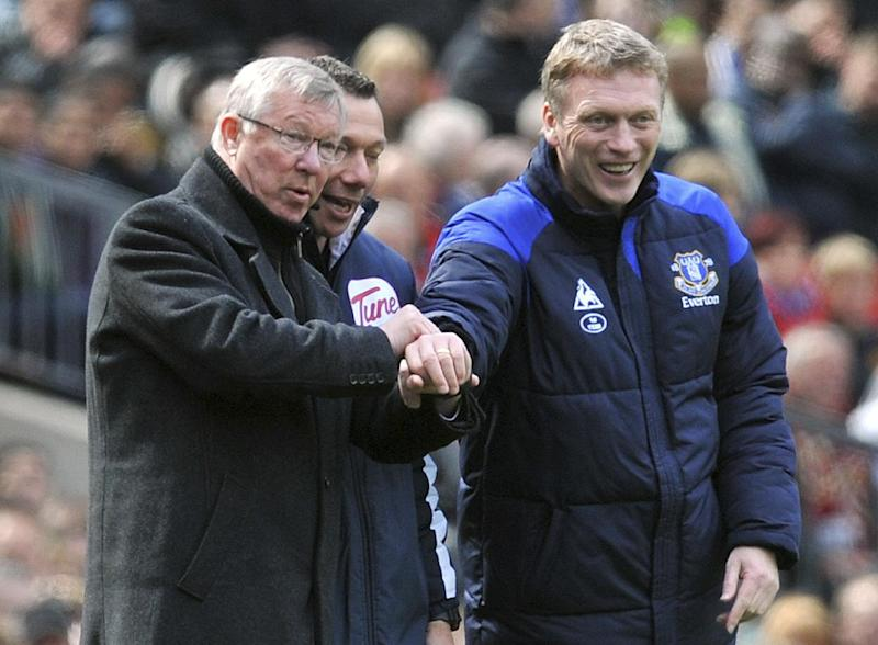 FILE - This is a April 22, 2012 file photo of Manchester United manager Sir Alex Ferguson, left, and Everton manager David Moyes during the Manchester United and Everton match at Old Trafford Manchester England . Everton said Thursday May 9, 2013 that its manager David Moyes is leaving the club at the end of the season and wants to replace Alex Ferguson at Manchester United. While United has not yet made an announcement on who will succeed Ferguson at Old Trafford, the statement from Everton clears the way for Moyes to be hired. (AP Photo/Martin Rickett/PA) UNITED KINGDOM OUT