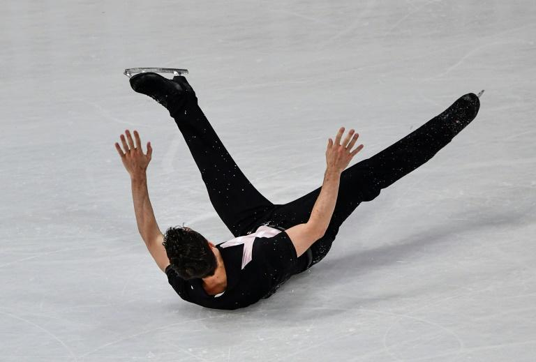 Spain's Javier Fernandez falls during the men's free skating event, to finish fourth, at the ISU World Figure Skating Championships in Helsinki, on April 1, 2017