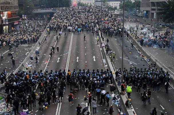 PHOTO: Protesters face off with police after they fired tear gas during a rally against a controversial extradition law proposal outside the government headquarters in Hong Kong, June 12, 2019. (Anthony Wallace/AFP/Getty Images)