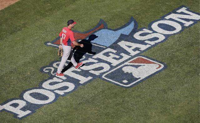 St. Louis Cardinals' John Mabry walks out to batting practice before Game 3 of the National League baseball championship series against the Los Angeles Dodgers, Monday, Oct. 14, 2013, in Los Angeles. (AP Photo/Jae C. Hong)
