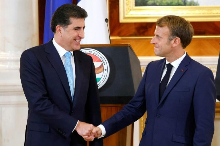 Macron held talks with Kurdish President Nechirvan Barzani (L) in Arbil and reiterated France's commitment to fight IS jihadists (AFP/Ludovic MARIN)