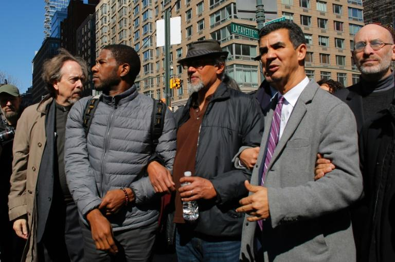 Ravi Ragbir (C), City Council Members Jumaane Williams (L) and Ydanis Rodriguez (R) exit from an immigration court hearing and speaking at a rally to show solidarity with individuals affected by deportation March 9, 2017 in New York