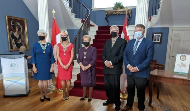 Lt. Gov. Antoinette Perry joins, from left, Dr. Heather Morrison, Noreen Corrigan, Maitland MacIsaac and P.E.I. Premier Dennis King at the Order of Prince Edward Island ceremony Wednesday at Government House. (Ken Linton/CBC - image credit)