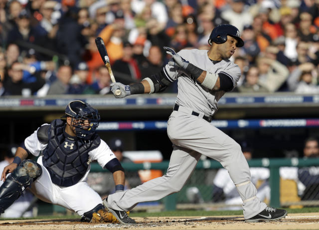 New York Yankees' Robinson Cano strikes out swing in the first inning as Detroit Tigers catcher Gerald Laird reaches for the ball during Game 4 of the American League championship series Thursday, Oct. 18, 2012, in Detroit. (AP Photo/Paul Sancya )