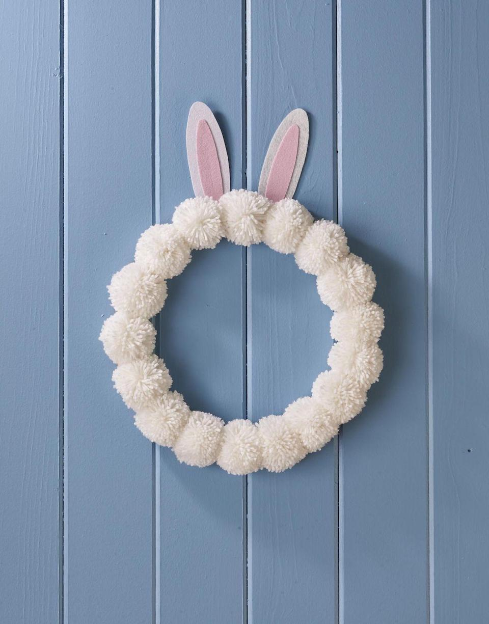 """<p>Soft and plush this wreath can be made with homemade or store bought pom-poms.<strong><br></strong></p><p><strong>To make:</strong> Make or buy 17 large white pom-poms. Attach to a 12-inch craft ring with hot-glue. Cut ears from white and pink felt; use glue to attach together and then to the back of the craft ring.</p><p><a class=""""link rapid-noclick-resp"""" href=""""https://www.amazon.com/Bright-Creations-Wedding-Floral-Natural/dp/B07Z8KDMBF/ref=sr_1_8?tag=syn-yahoo-20&ascsubtag=%5Bartid%7C10050.g.4088%5Bsrc%7Cyahoo-us"""" rel=""""nofollow noopener"""" target=""""_blank"""" data-ylk=""""slk:SHOP CRAFT RING"""">SHOP CRAFT RING</a></p>"""