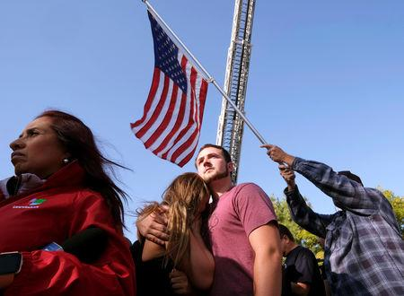 People attend the procession for the Ventura County Sheriff Sgt. Ron Helus