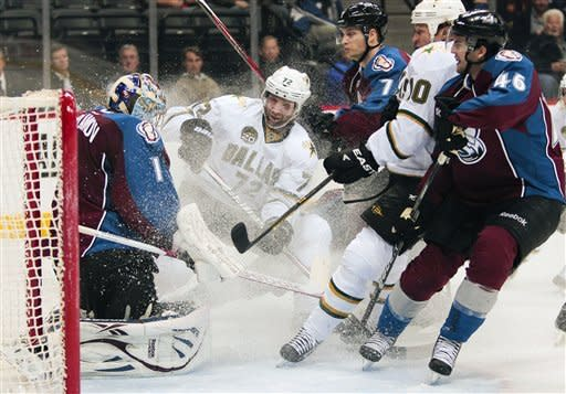 Dallas Stars right wing Erik Cole (72) attacks Colorado Avalanche goalie Semyon Varlamov (1), of Russia, who makes the save, during the second period of an NHL hockey game on Wednesday, March 20, 2013, in Denver. (AP Photo/Barry Gutierrez)
